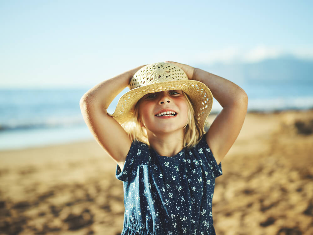 Picture of child in sunhat at the beach