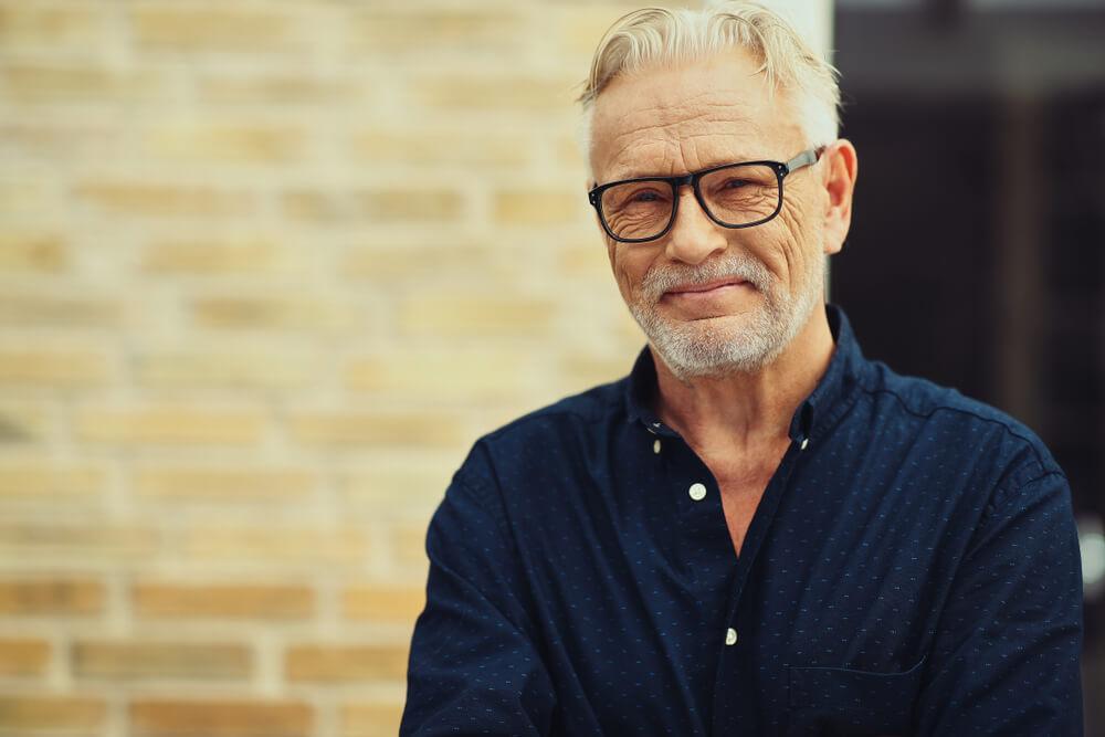 mature man wearing glasses