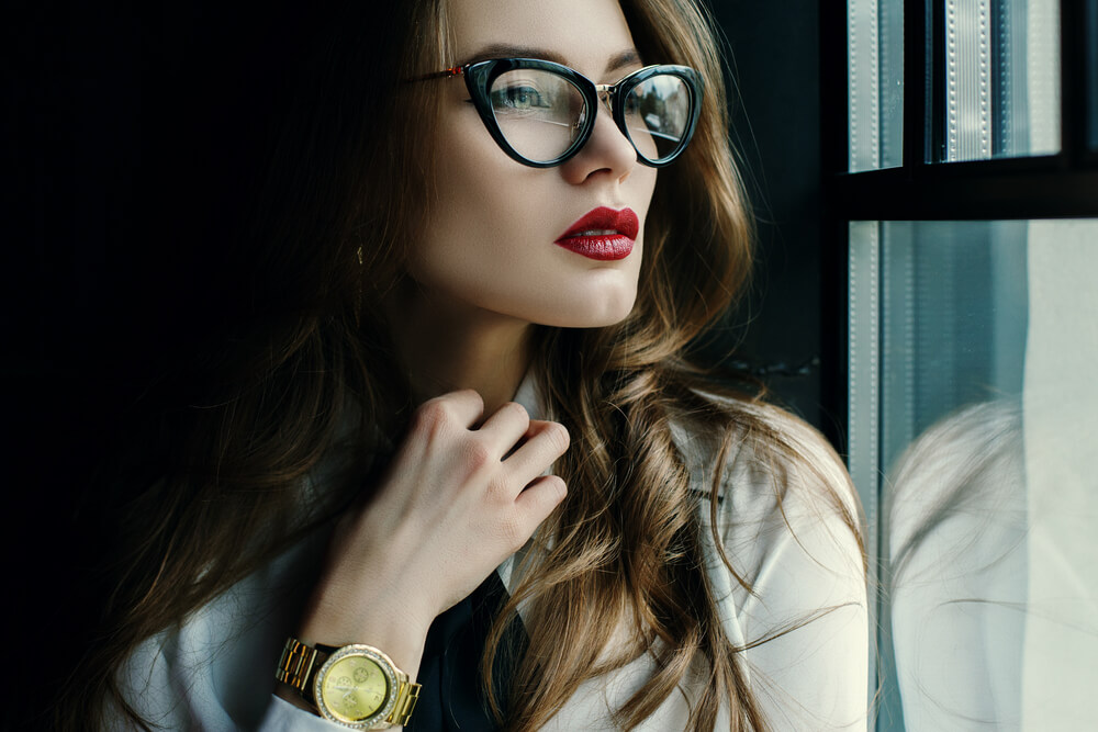 Beautiful young woman in stylish glasses